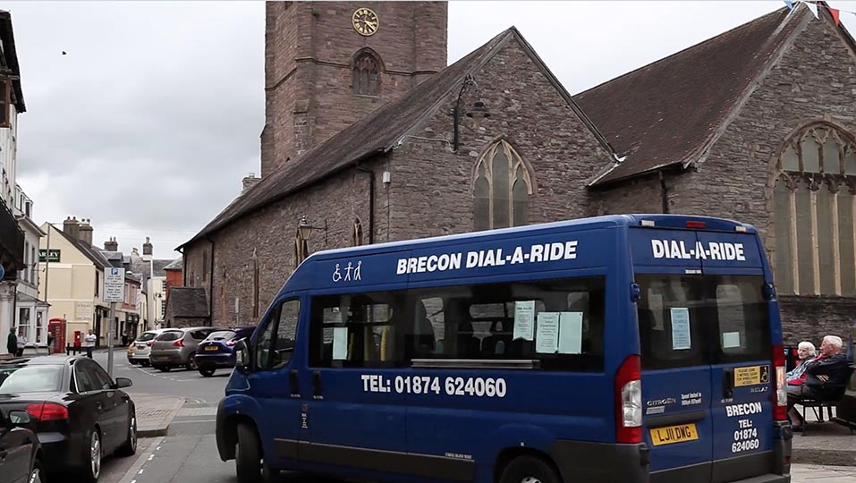 Dial-a-ride van turning a corner in the UK.